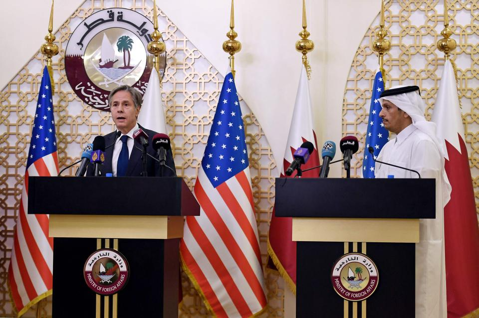 US Secretary of State Antony Blinken and Qatari Deputy Prime Minister and Foreign Minister Mohammed bin Abdulrahman al Thani (R) hold a joint press conference in the Qatari capital Doha, on September 7, 2021.
