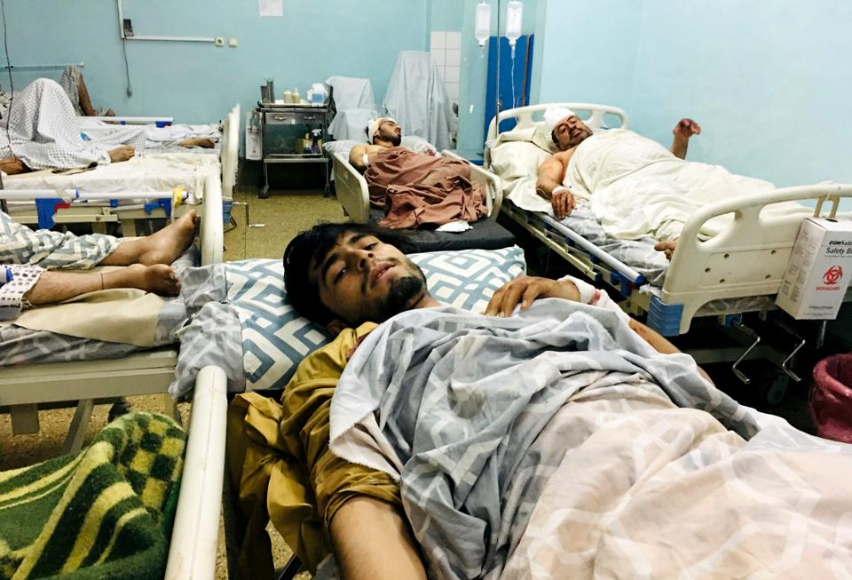 Wounded Afghans lie on a bed at a hospital after a deadly suicide bombing carried out by Daesh outside the airport in Kabul, Afghanistan, Thursday, Aug. 26, 2021.
