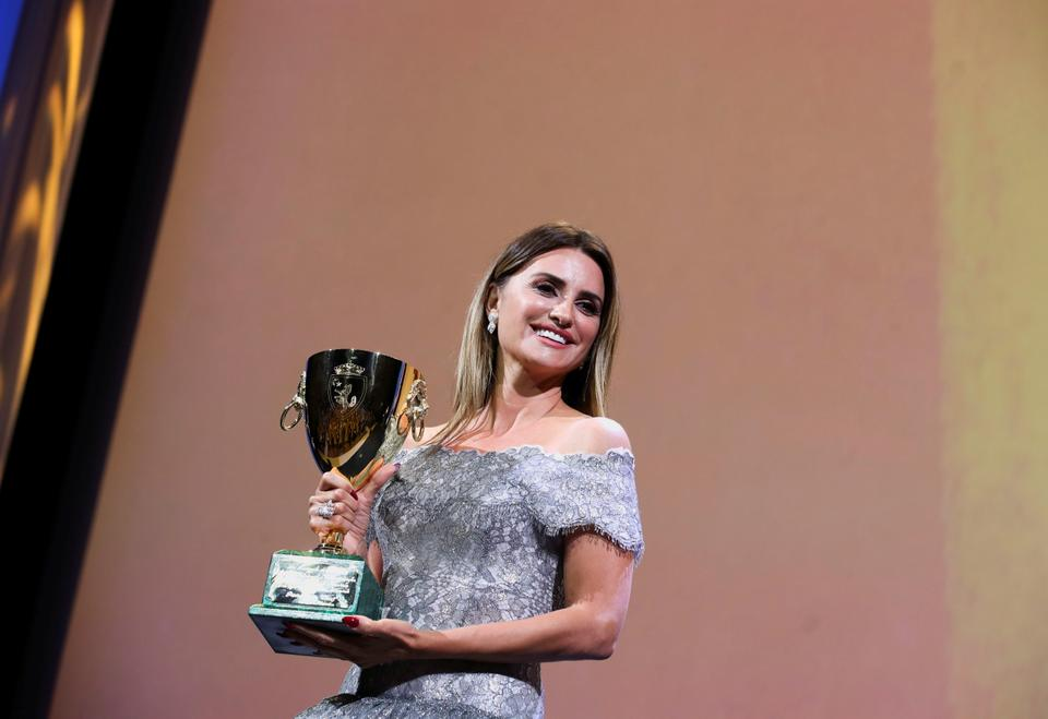 Actor Penelope Cruz holds her Coppa Volpi Award for Best Actress.