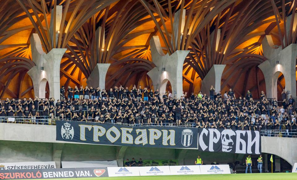 The ultras of FK Partizan wait for the kick-off prior to the UEFA Europa League Play-offs 2nd Leg match between Videoton FC and FK Partizan at Pancho Arena on August 24, 2017 in Felcsut, Hungary.