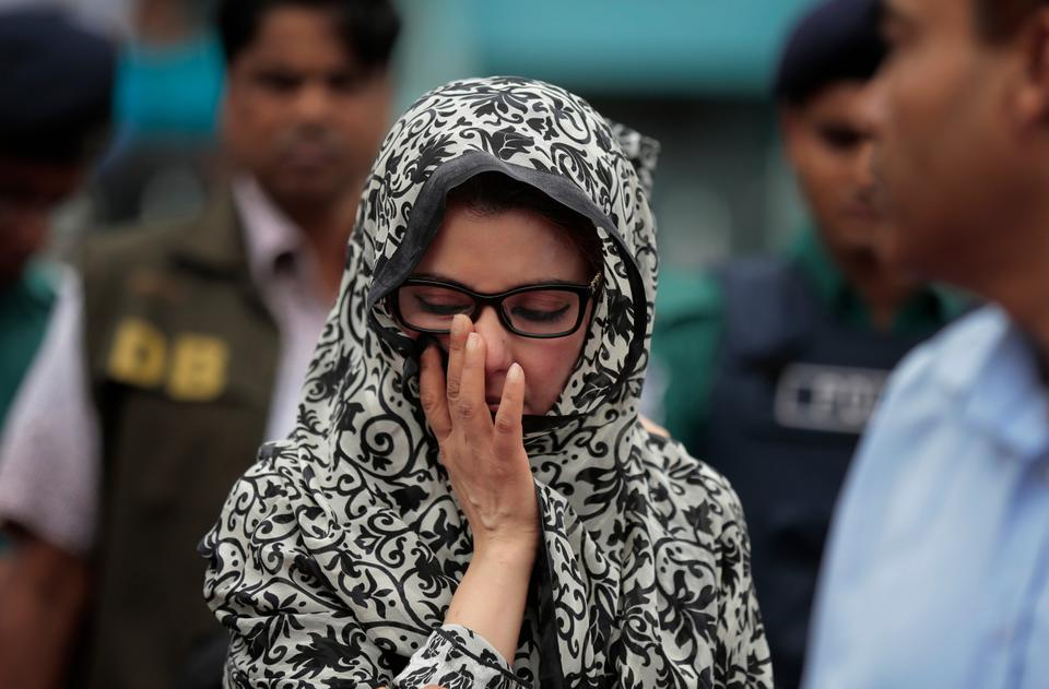 A relative of Bangladeshi victims of the attack on Holey Artisan Bakery react as people pay tribute to the deceased, at a stadium in Dhaka, Bangladesh, Monday, July 4, 2016.