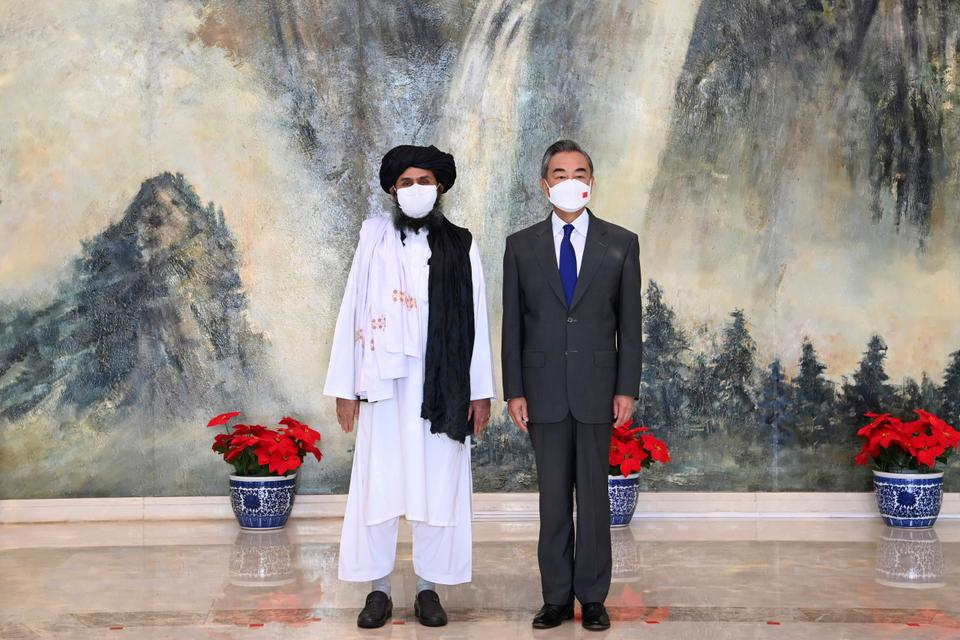 Taliban co-founder Mullah Abdul Ghani Baradar, left, and Chinese Foreign Minister Wang Yi pose for a photo during their meeting in Tianjin, China, on July 28, 2021. While well-positioned to expand its influence post-US departure, Beijing's worries that Afghanistan under the Taliban could again become fertile ground for extremist groups.