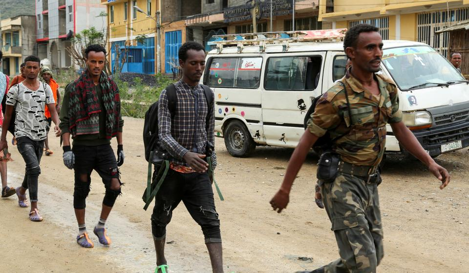 Newly recruited youth joining Tigrayan forces march through the village of Nebelet, northern Tigray, Ethiopia (REUTERS)