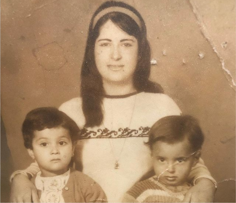 Ameera Adnan's grandmother in the middle holding her mother on the left and her uncle on the right.  Old photos of his family played a major role in shaping his creative output.