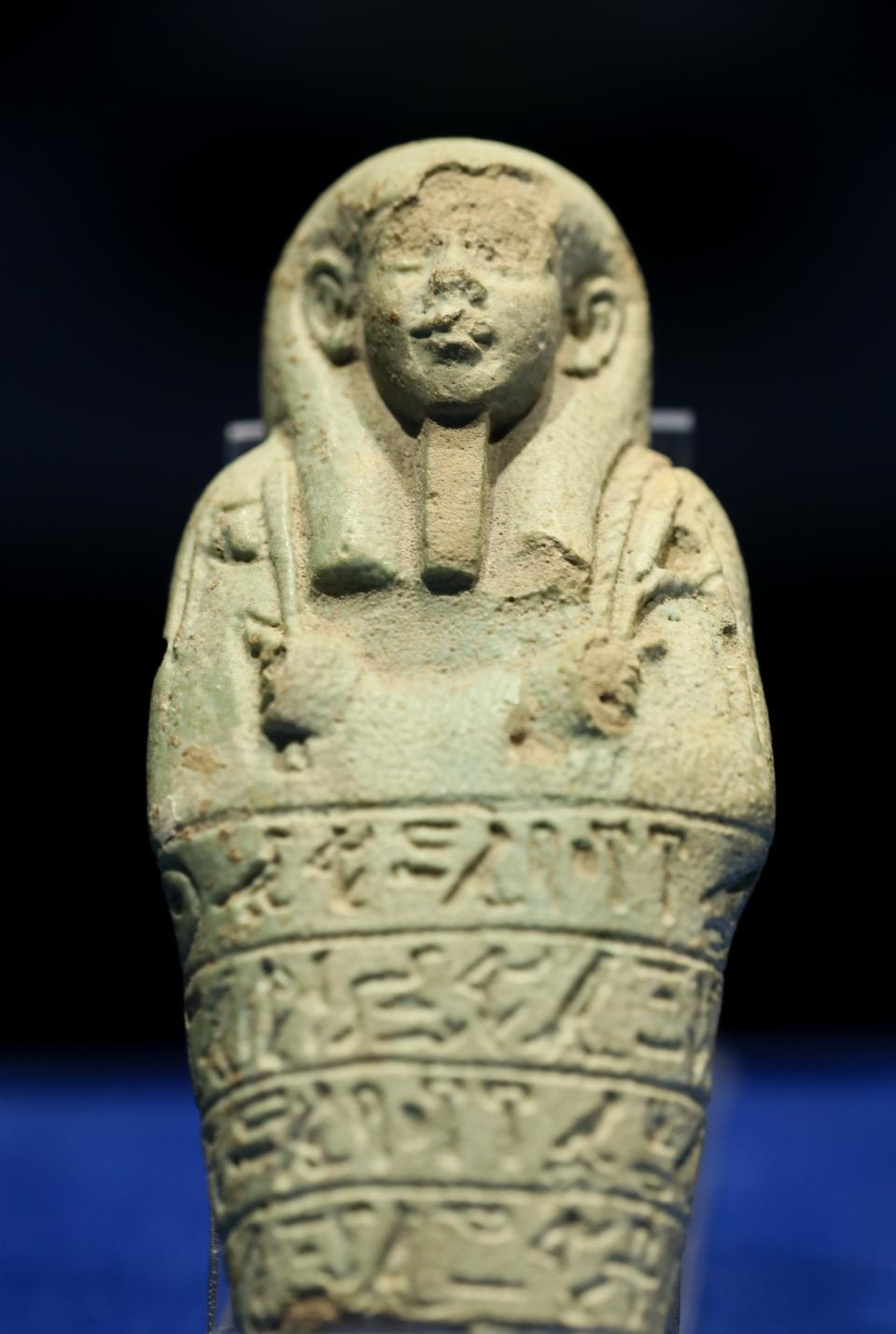 An ushabti figurine with hieroglyphic writing on it on display at the Izmir Archaeological Museum.