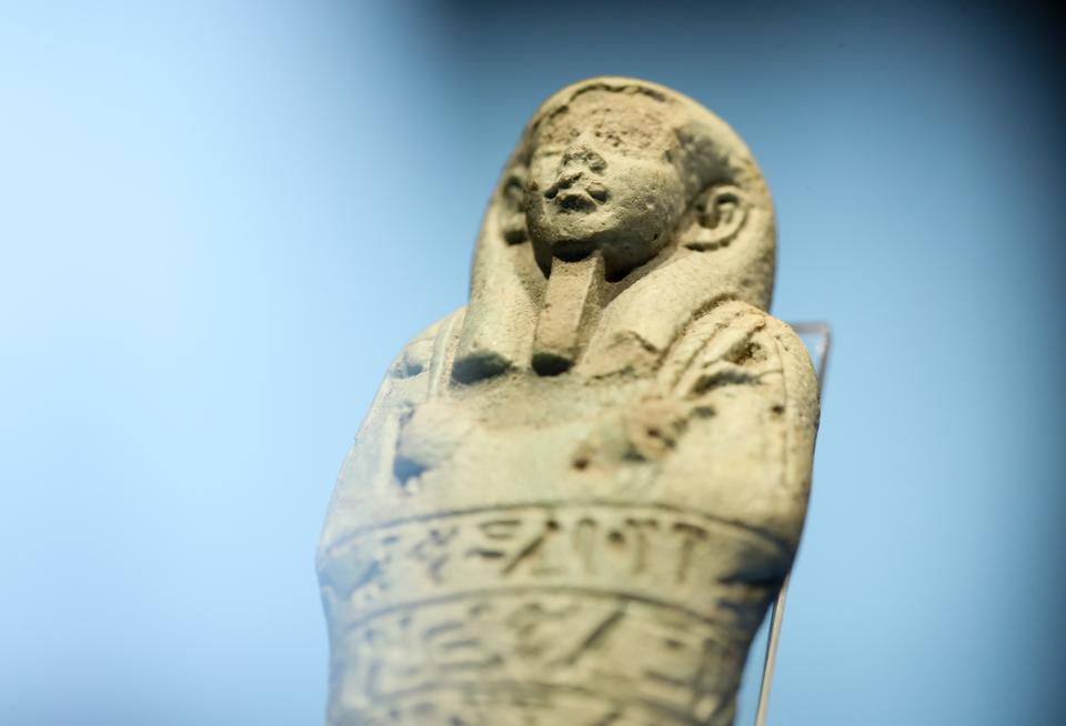 Close up of an ushabti figurine with hieroglyphic writing on it on display at the Izmir Archaeological Museum.