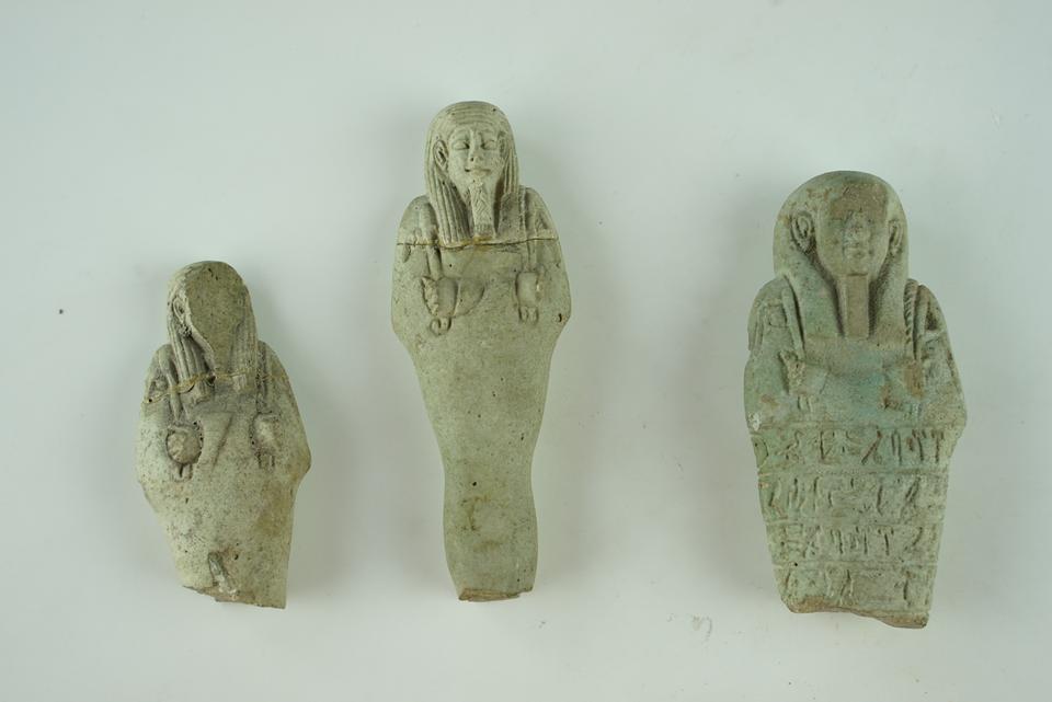 Three ushabti figurines on display at the Izmir Archaeological Museum in western Turkey.