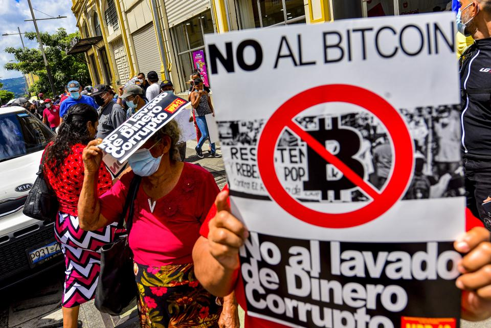 A placard against the government's Bitcoin law, during the protest. Thousands of Salvadorans took to the streets on El Salvador's Bicentennial Independence Day against El Salvador's President Nayib Bukele and his government's policy to adopt Bitcoin as legal tender.