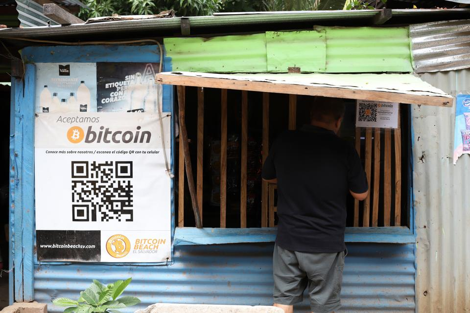 A worker at Hope House, an organization that sponsors the use of cryptocurrencies in El Zonte beach, makes a purchase at a small store that accepts Bitcoin, in Tamanique, El Salvador, Wednesday, June 9, 2021.