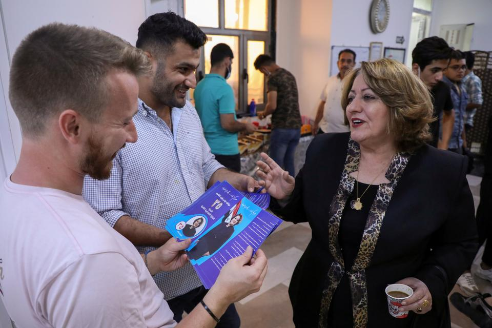 Awatef Rasheed, an Iraqi women's rights activist running as an independent candidate in the upcoming parliamentary elections, speaks with her supporters in Basra, Iraq September 14, 2021.