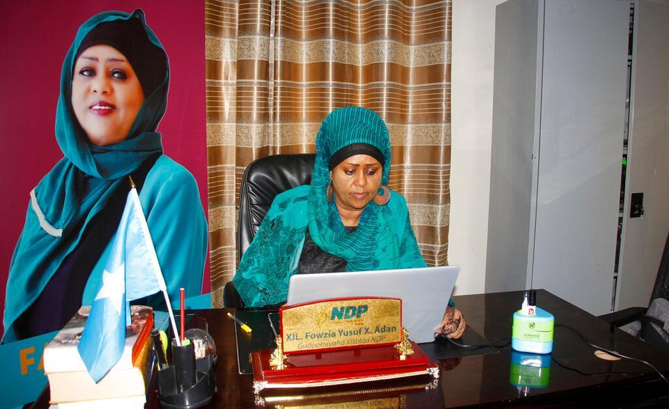 Fawzia Yusuf H. Adam sits in her office in Mogadishu, Somalia