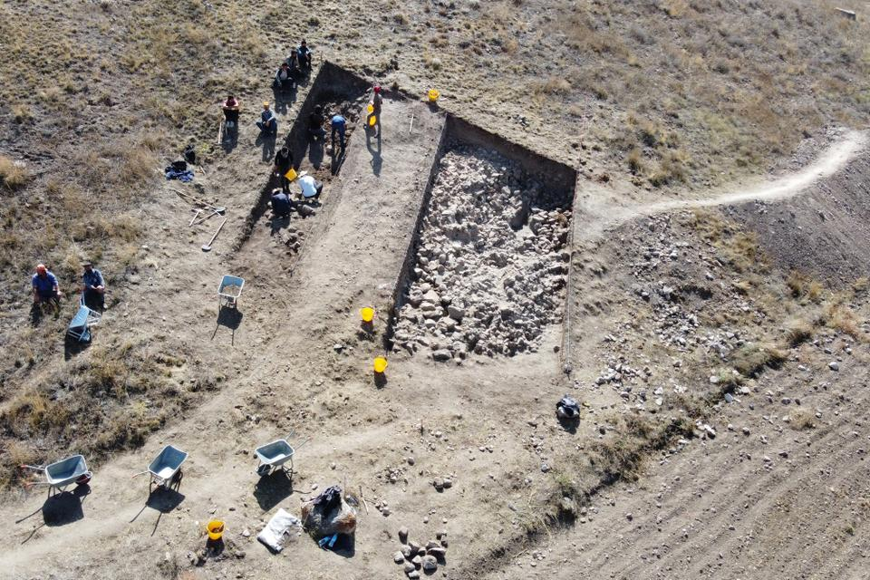 An aerial view taken on September 21, 2021 shows archaeologists working of the site of the