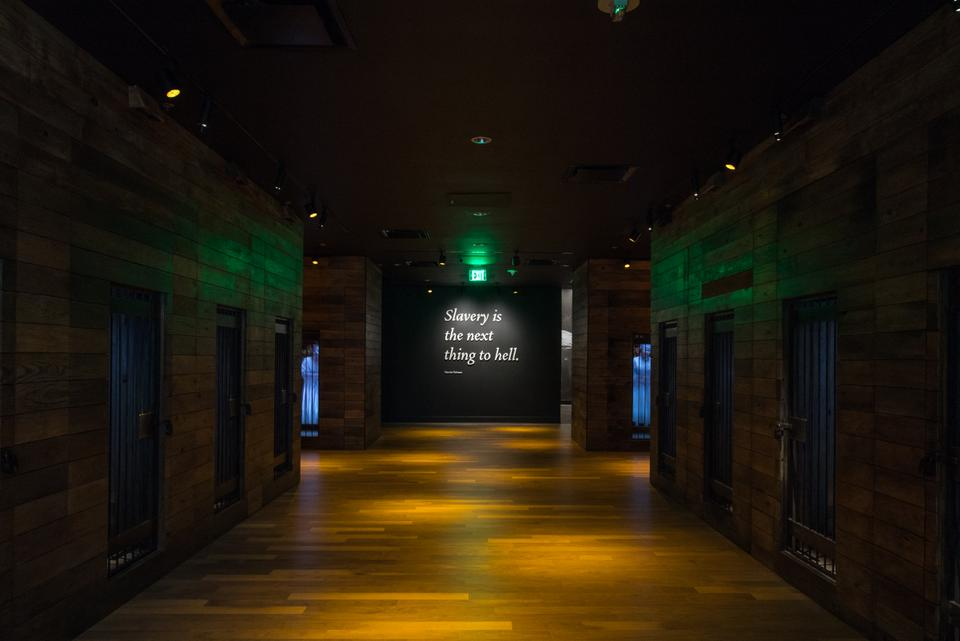 Image courtesy of the Equal Justice Initiative, shows an exhibit that reads ''Slavery is the next thing to hell'' at the Legacy Museum
