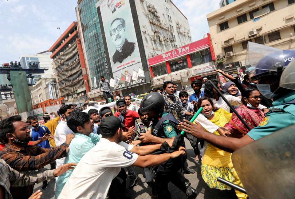 While Bangladesh maintains good relations with India, Prime Minister Narendra Modi's pro-Hindu policies do not help improve ties between the two countries. Protestors clash with security officers during a protest against the visit of Modi in Dhaka, Bangladesh, March 25, 2021.