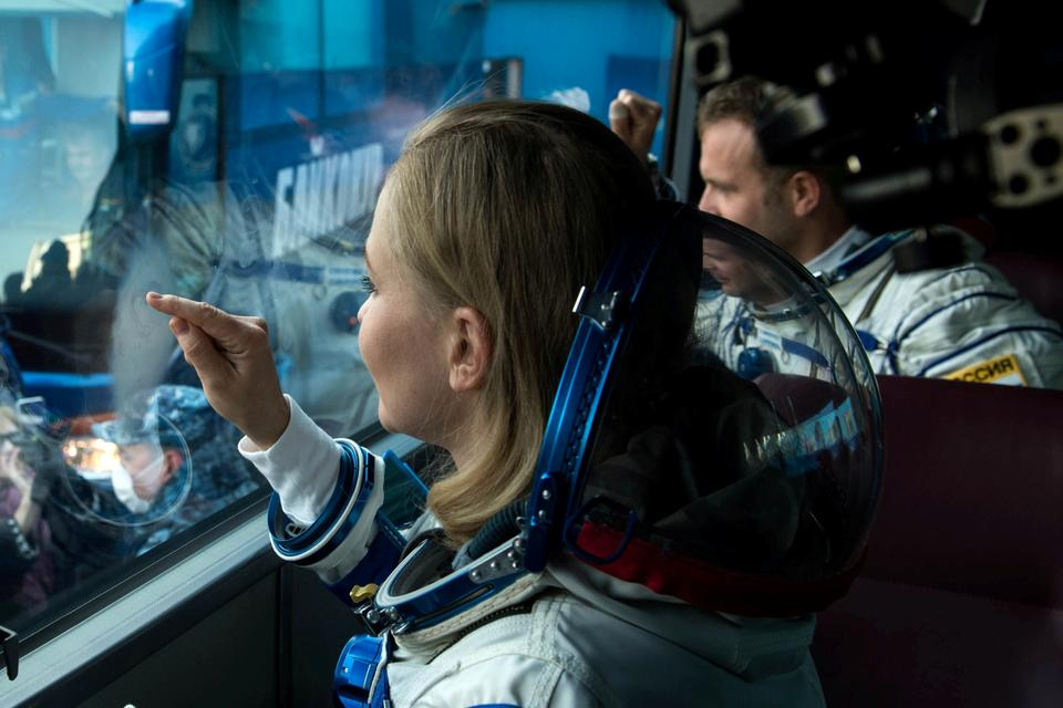 Russian actor Yulia Peresild gestures in a bus as she departs for boarding the Soyuz MS-19 spacecraft for the launch at the Baikonur Cosmodrome, Kazakhstan October 5, 2021.