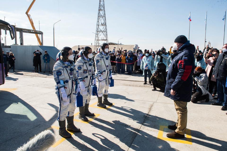 Russian cosmonaut Anton Shkaplerov, film director Klim Shipenko and actor Yulia Peresild report before boarding the Soyuz MS-19 spacecraft for the launch at the Baikonur Cosmodrome, Kazakhstan October 5, 2021.