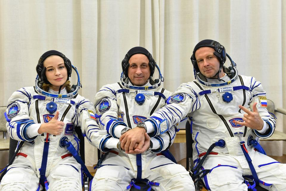 Russian cosmonaut Anton Shkaplerov, film director Klim Shipenko and actor Yulia Peresild pose after donning space suits shortly before the launch at the Baikonur Cosmodrome, Kazakhstan October 5, 2021.