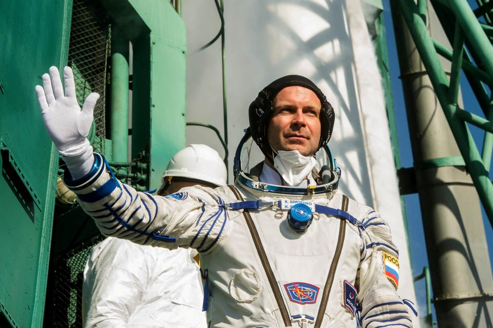 Russian film director Klim Shipenko waves farewell as he boards the spacecraft for the launch at the Baikonur Cosmodrome, Kazakhstan October 5, 2021.