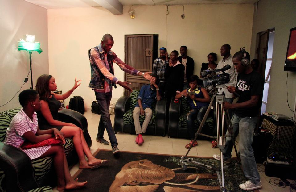 Nollywood actors perform a scene in Lagos, Nigeria, September 18. 2013.