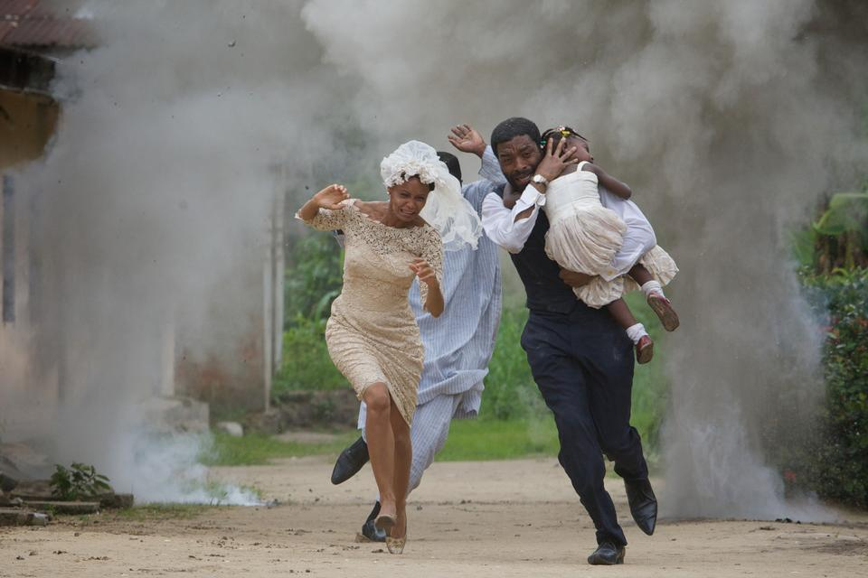 Actress Thandie Newton and actor Chiwetel Ejiofor, right, act in a film ''Half of a yellow sun'' in Calabar, Nigeria, May 17, 2012.
