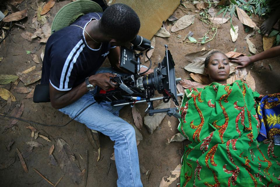 A cameraman films a scene for the movie