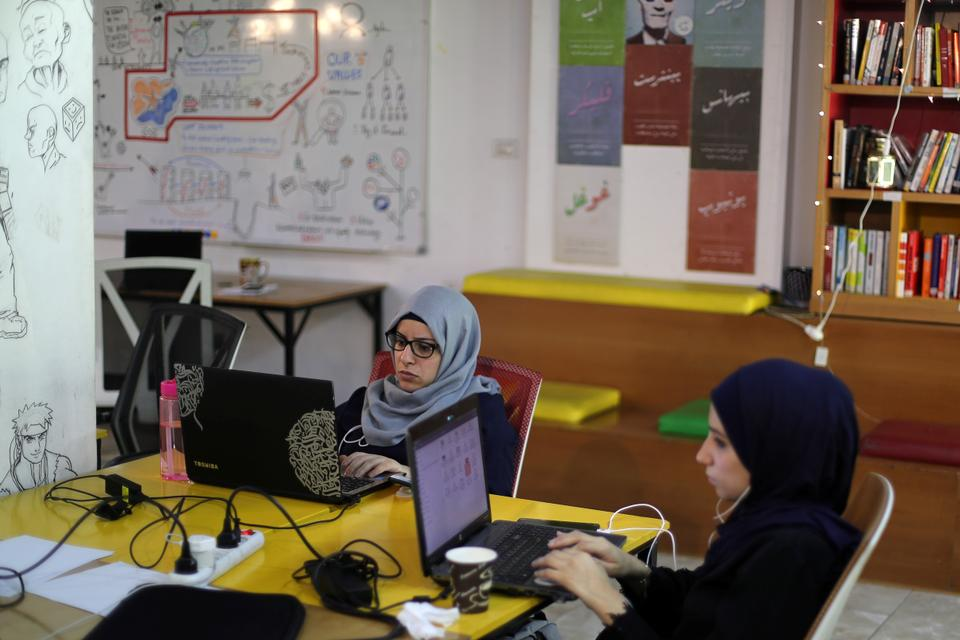 Palestinian entrepreneurs and freelancers work at the Gaza Sky Geeks tech hub in Gaza City / file