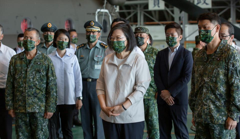 Taiwan President Tsai Ing-wen visits helicopter pilots preparing for the upcoming National Day celebrations, at an air base in Taipei, Taiwan October 8, 2021.