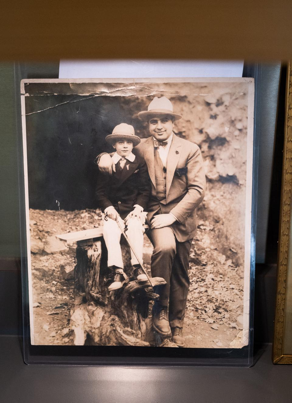 A photograph of Al Capone with his son, Sonny, is displayed at Witherell's auction house in Sacramento, California