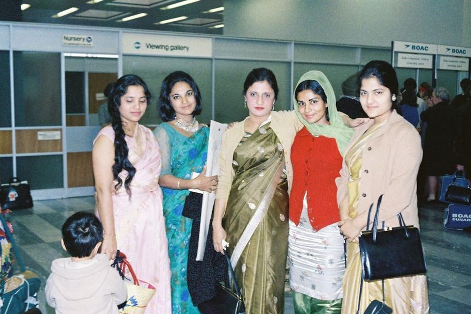My grandmother, Farida Khan (middle), with two dancers from the PIA Arts Academy to her right and left, as my family dropped them off to Heathrow Airport after a performance in the UK.