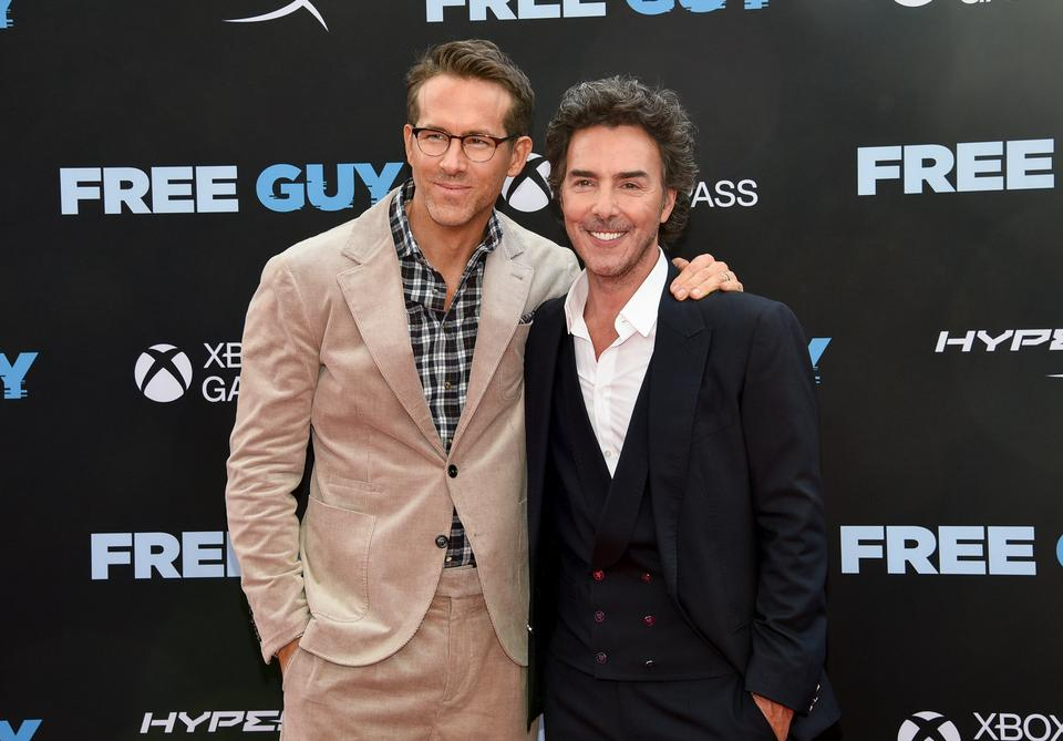 Actor Ryan Reynolds, left, and director Shawn Levy pose together at the world premiere of