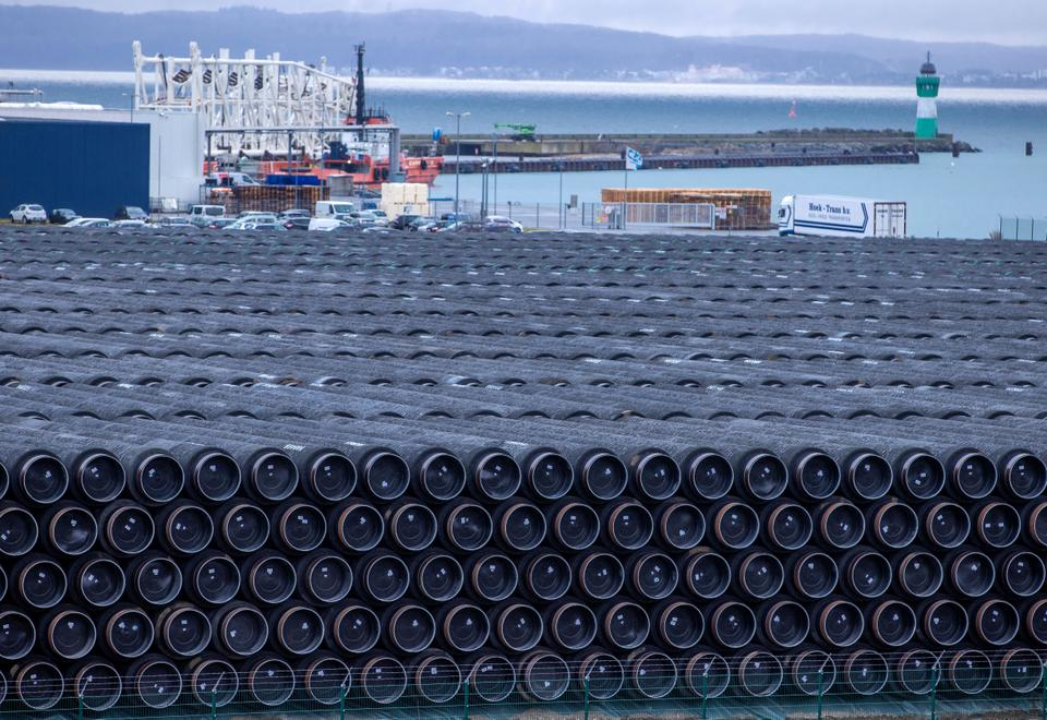 Pipes for the construction of the Nord Stream 2 natural gas pipeline from Russia to Germany and the Baltic Pipe from Denmark to Poland are stored at the port of Mukran in Sassnitz on the island of Ruegen, Germany, Wednesday, Jan. 6, 2021.