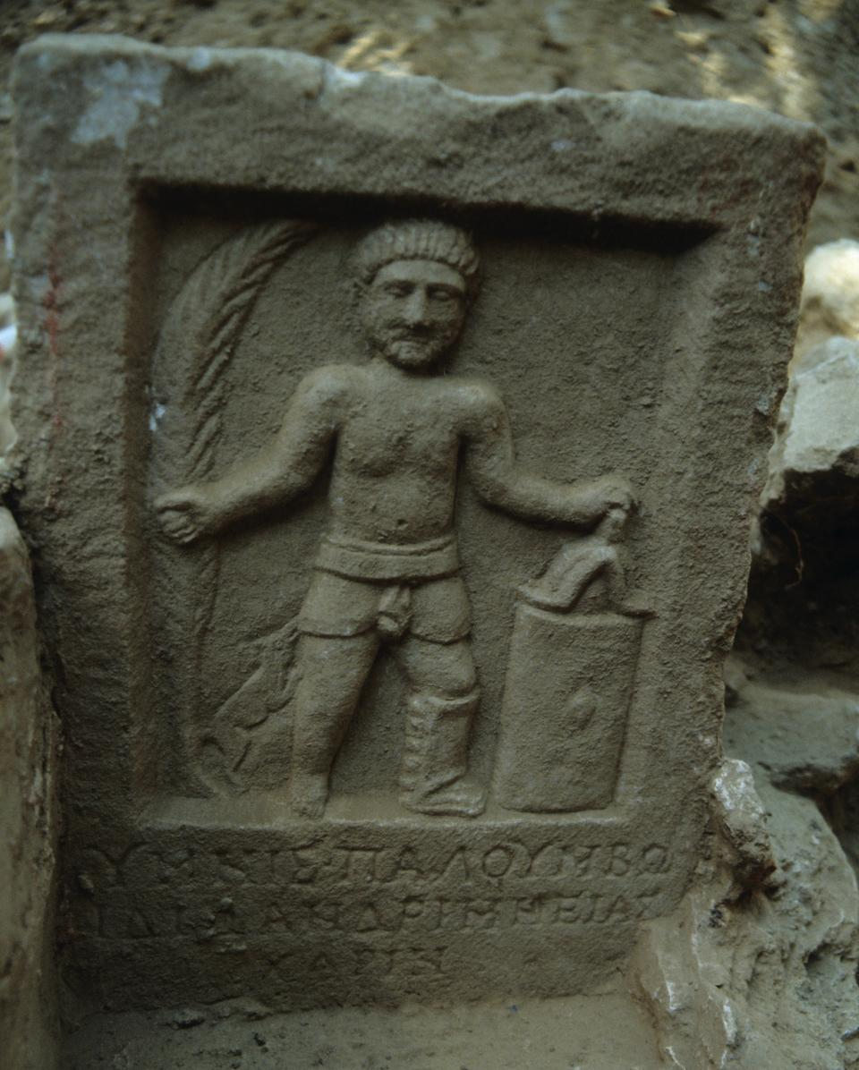 The funerary stele of gladiator Palumbos, depicting him with a palm leaf symbolising victory.