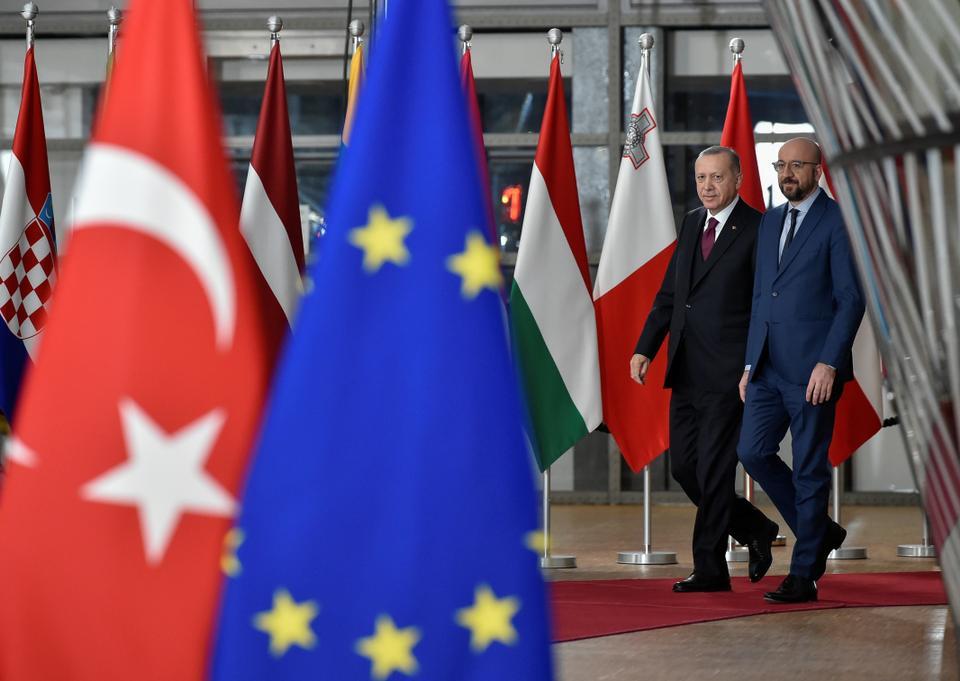 EU Council President Charles Michel (R) arrives with Turkey's President Recep Tayyip Erdogan before a meeting with European Commission President Ursula von der Leyen