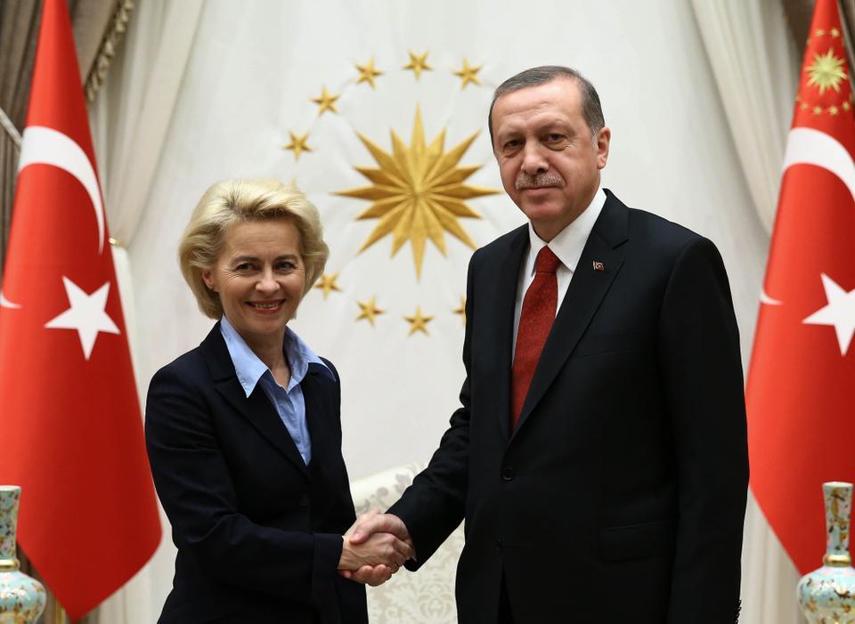 Turkey's President Recep Tayyip Erdogan, right, and EU Commission president Ursula Von der Leyen shake hands