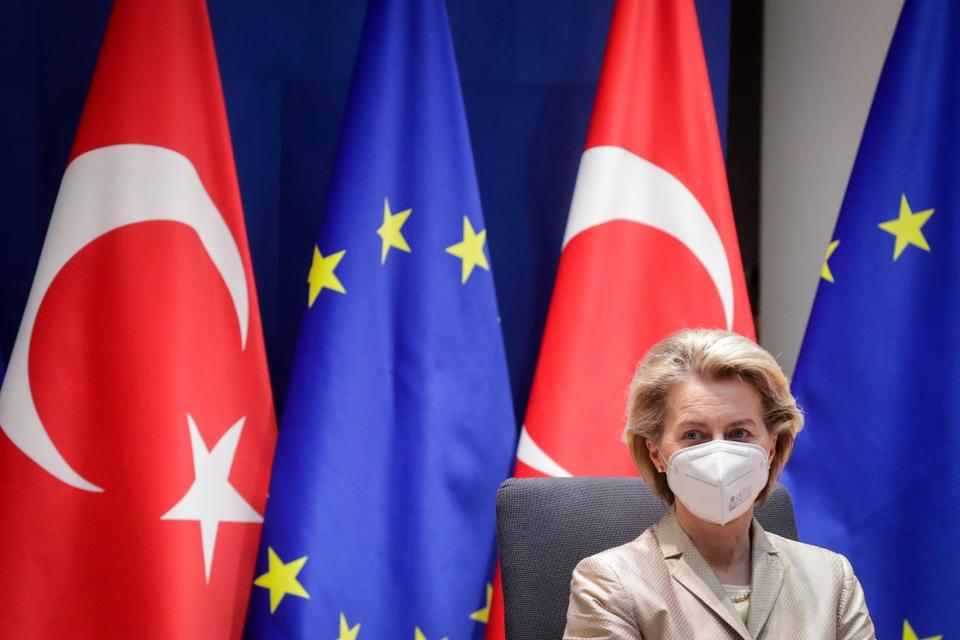 European Commission President Ursula von der Leyen wears a mask as she attends a video call with Turkey's President Recep Tayyip Erdogan