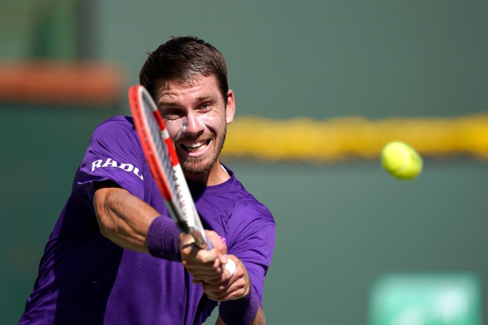 Cameron Norrie, of Britain, returns to Grigor Dimitrov, of Bulgaria, in a semifinal match at the BNP Paribas Open tennis tournament, October 16, 2021, in Indian Wells, California.