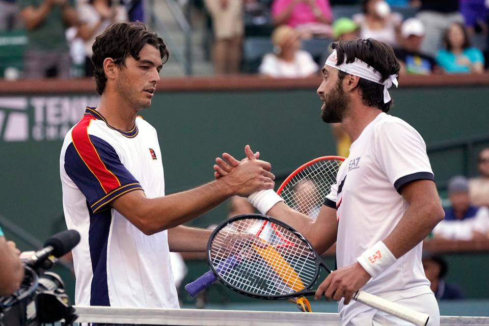 Nikoloz Basilashvili, of Georgia, right, is greeted by Taylor Fritz, of the United States, after Basilashvili beat Fritz in a semifinal match at the BNP Paribas Open tennis tournament, October 16, 2021, in Indian Wells, California