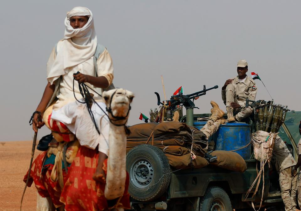 Gen. Mohammed Hamdan Dagalo, the commander of Rapid Support Forces, sits on his vehicle surrounded by soldiers from the RSP during a military-backed tribal rally in the East Nile province, Sudan.