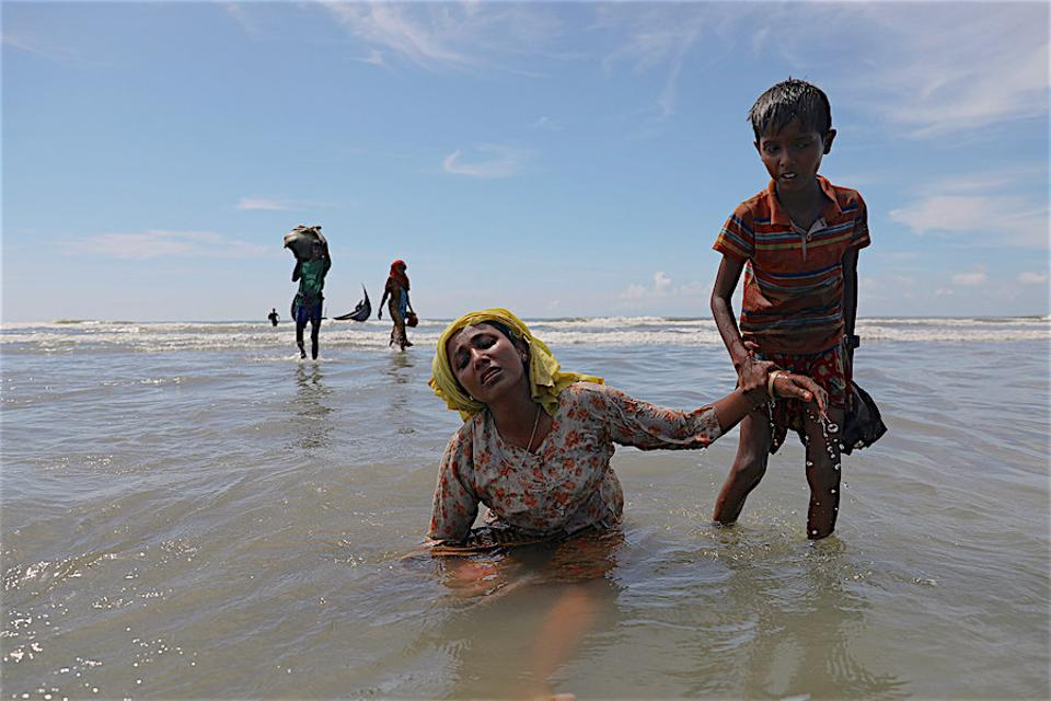 Tens of thousands more Rohingya are stranded on  the border, waiting for Bangladeshi forces to allow them to enter. (AP)
