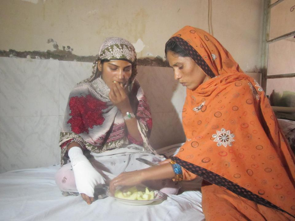 Saba Maqsood at a hospital in Hafizabad, Pakistan, after her family drove her to the district and tried to kill her. Saba's father and uncle shot her and dumped her body in the river where the shock of the cold water revived her. Saba managed to reach land and get help, surviving gunshots which grazed her cheek and right hand. June 2014.