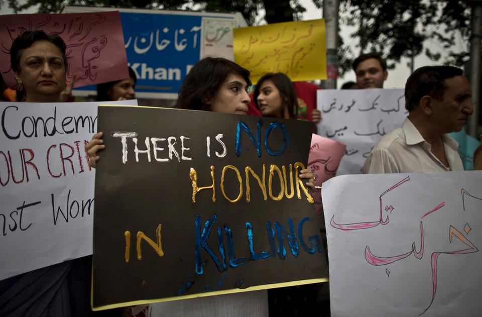 Members of Pakistan's civil society protest the killing of a pregnant woman, Farzana Parveen, who was stoned to death by her family, in Islamabad, Pakistan, on May 29, 2014. Mohammed Iqbal, Farzana's husband and her lawyer said the family was angry because they wanted her to marry someone else.