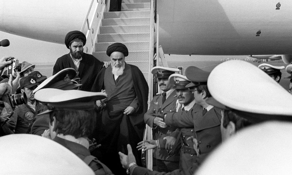 Ayatollah Ruhollah Khomeini is welcomed at Tehran airport after his return from exile in France on Feb.1979.
