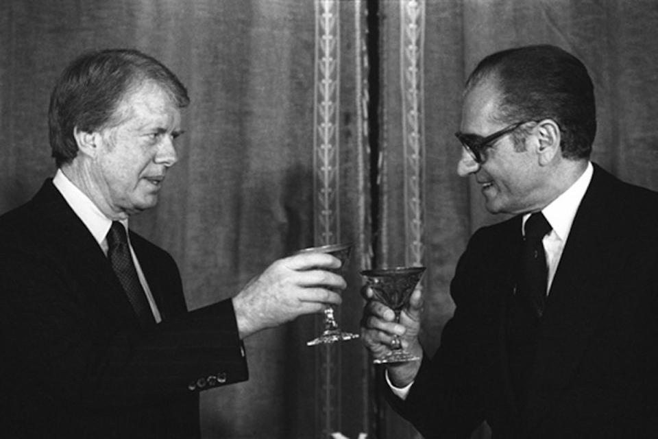 President Jimmy Carter toasts the Shah Mohammad Reza Pahlavi of Iran during New Year's Eve dinner at Niavaran Palace in Tehran, Iran on  Dec. 31, 1977.