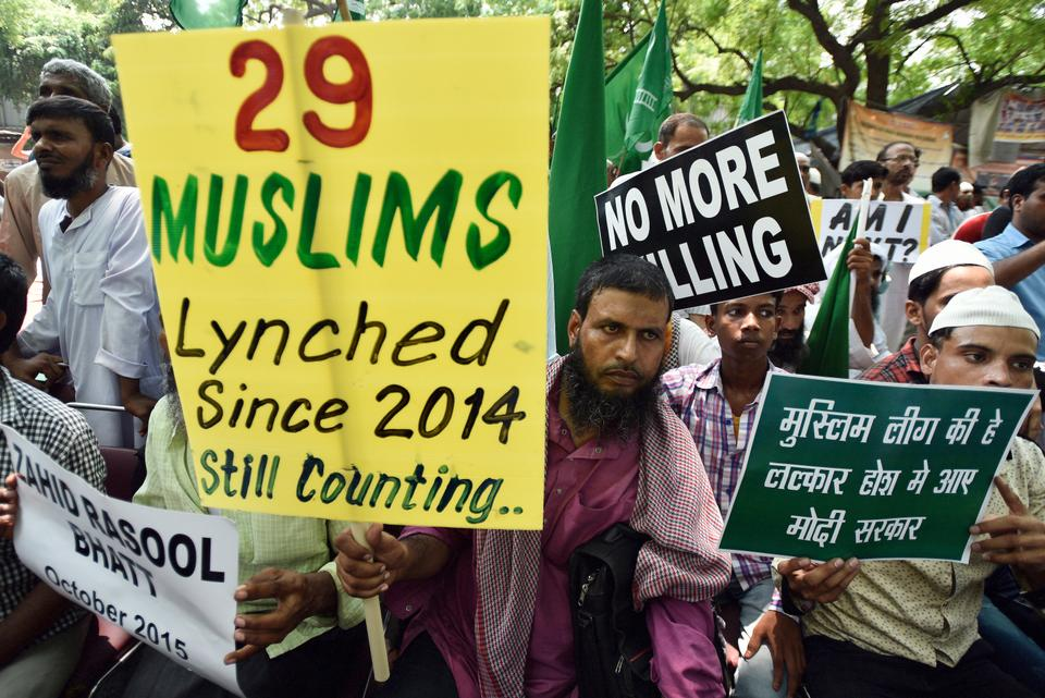Protesters hold placards as they take part in a sit-in over a spate of assaults against Muslims and low-caste Dalits by Hindu vigilantes, on July 18, 2017 in New Delhi, India.
