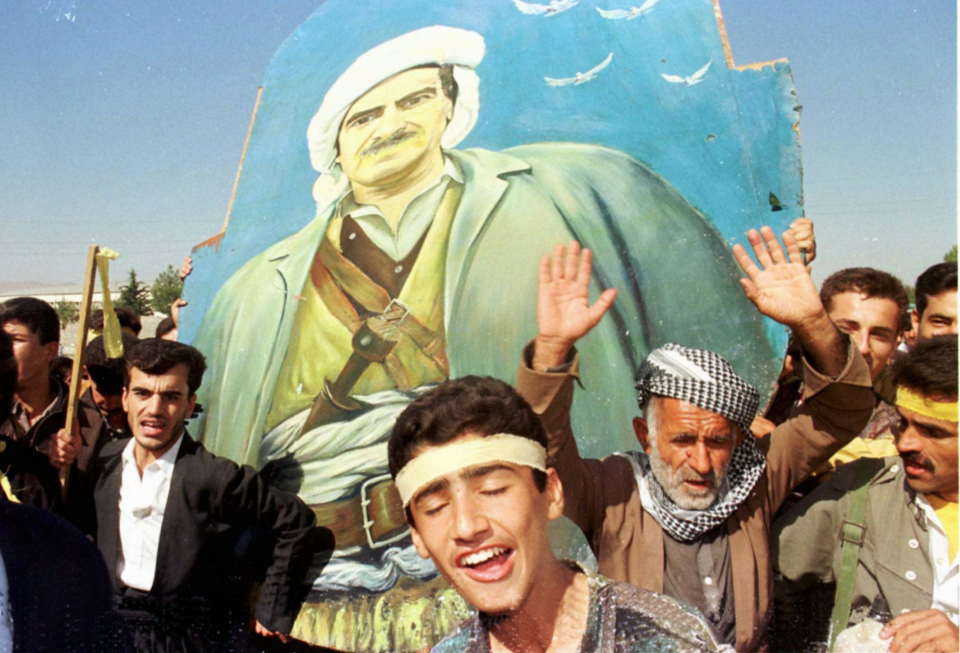 Shouting victory slogans and carrying a 3-meter high picture of their leader Masoud Barzani, members of the KDP celebrate with an impromptu parade in Sulaymaniyah, Iraq, Tuesday September 10, 1996.