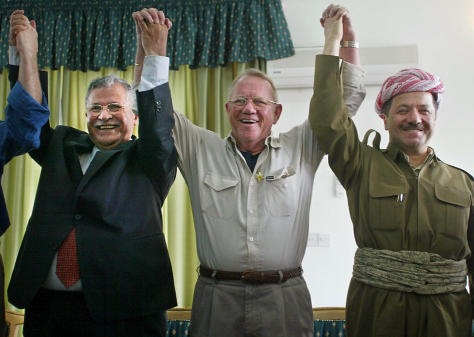 Retired US Lt General Jay Garne raises arms with PUK leader Jalal Talabani, left, and KDP leader Massoud Barzani, in Dokan, northern Iraq on April 22, 2003. Garner's visit to the autonomous Kurdish region in Northern Iraq was welcomed by the mostly pro-American Kurds.