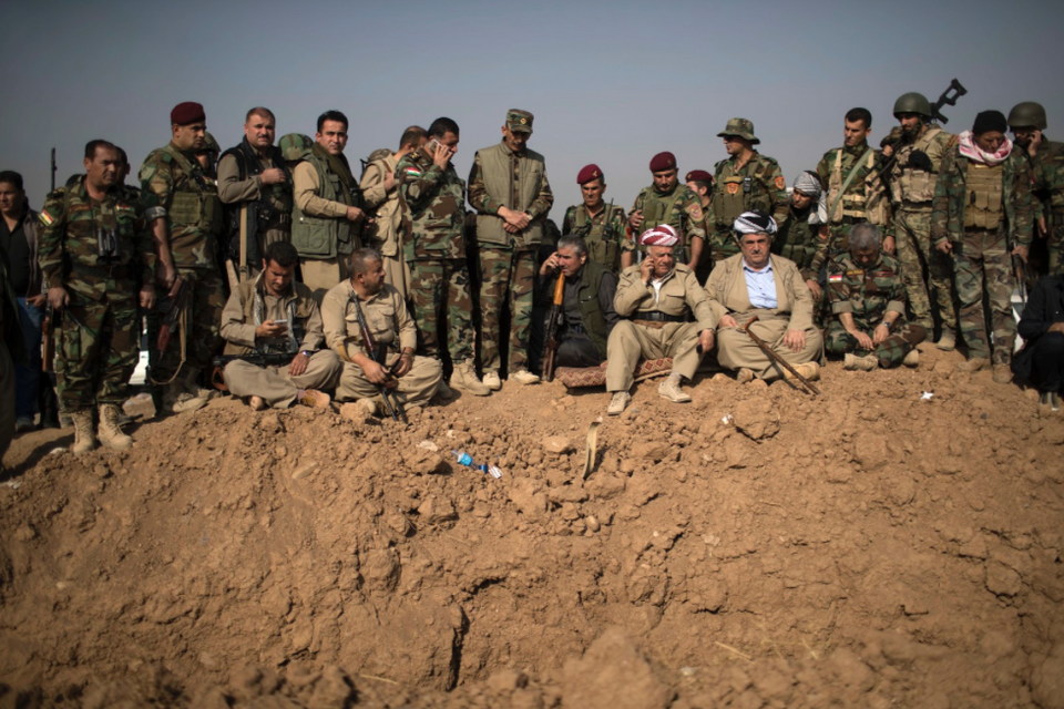Kurdish Peshmerga fighters and commanders overlook Daesh positions during heavy fighting in Bashiqa, east of Mosul, Iraq, Monday, Nov. 7, 2016.