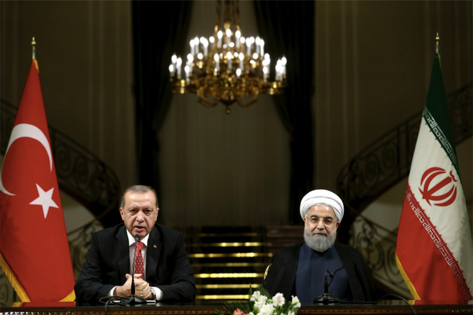 Turkish President Recep Tayyip Erdogan, left, speaks with media during a joint press conference with Iranian President Hassan Rouhani on Oct. 4, 2017. With Turkey's president by his side, Iranian President Hassan Rouhani pledged that they would ensure borders in the region remain unchanged after the recent Kurdish independence referendum in Iraq.