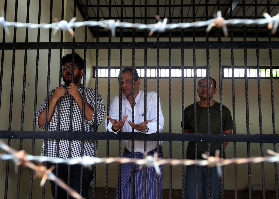 TRT World crew, Aung Naing Soe, Hla Tin, and Lau Hon Meng stand for their first court appearance after found possessing a drone on Friday, Nov. 10, 2017, in Myanmar's capital Naypyidaw.