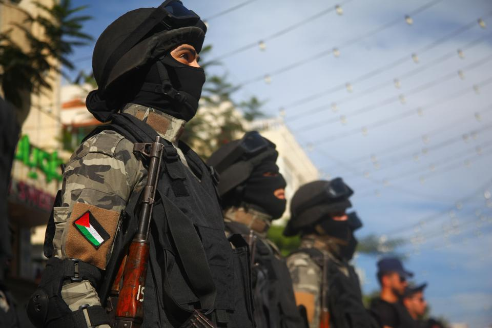 Soldiers stand at attention during a parade marking the 29th anniversary of Palestinian Declaration of Independence in Hebron, West Bank on November 14, 2017.